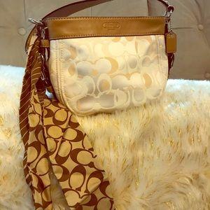 Elegant small cream Coach bag
